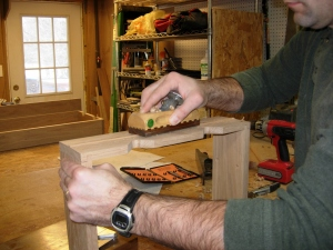 Cut down the drawers, now I am planing the remaining piece in the center