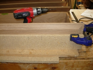 the pre-drilled particle board should keep my drill straight