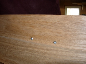 They are installed slightly above center to avoid having to drill through the drawer as well