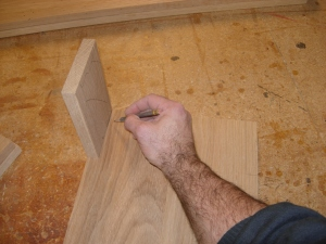 Using a support rail cut-off to mark the legs