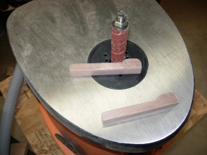 Shaping the retainers on the spindle sander