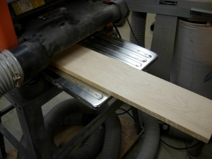 Planing down a piece of maple