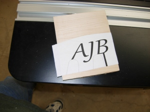 Initials glued to the maple