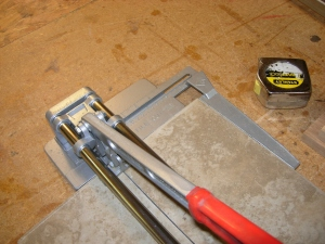 Cutting a tile to fit the top shelf