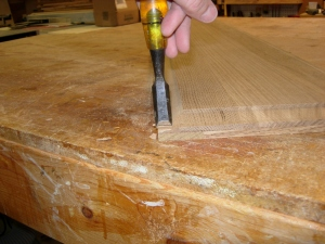 Using the chisel to cut a square corner