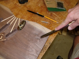 Carving the jack cavity with a spindle gouge.