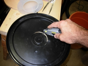 Cutting out the hole in the lid