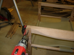 Drilling the pivot hole through the arms
