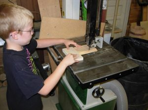 Adam using the bandsaw