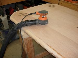 Sanding down the wood filler