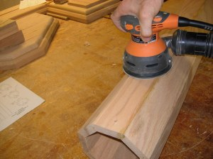 Sanding down the wood filler