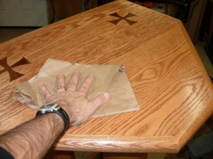 Polishing the finish with a brown paper bag