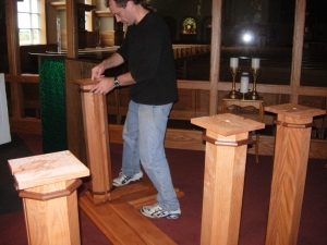 Me assembling the altar parts