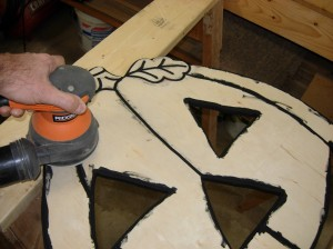 Sanding off the over-painted surfaces