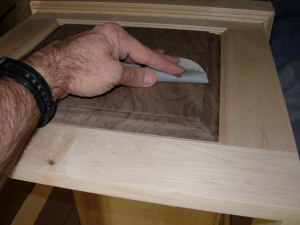 Sanding down the raised grain