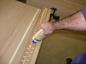Attaching spacer and applying glue