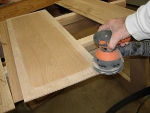 Sanding the panel down