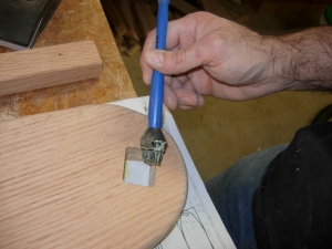 Applying glue to the mortise
