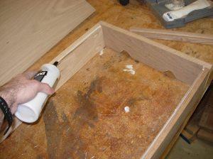Applying glue to the rabbet