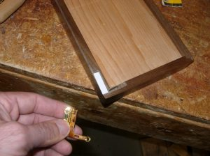 Shimming the first hinge