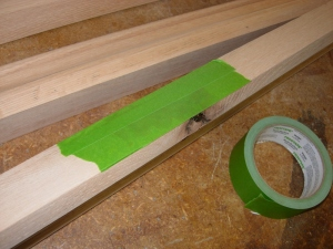 Tape the knot to hold the epoxy in