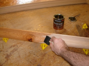 Applying the first coat of urethane