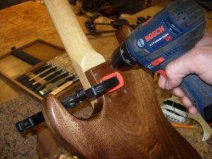 Drilling pilot holes for mounting the neck
