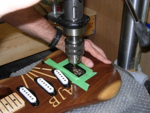 Drilling through holes for the strings