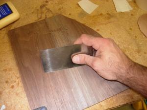 Using a card scraper to blend the seam