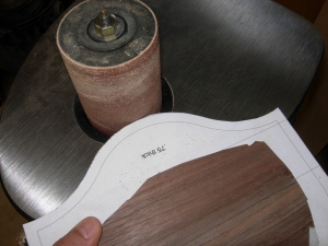 Running it along the spindle sander