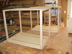 Two more cabinet boxes being assembled