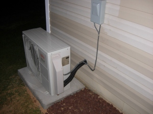 Refrigerant lines and power connected outside