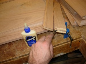 Applying glue to the rail ends