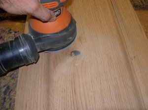Sanding the scraped surface
