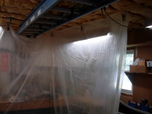 Hanging plastic for a temporary spray booth