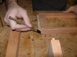 Applying glue to the tenons