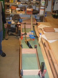 All three squared, clamped, and drying