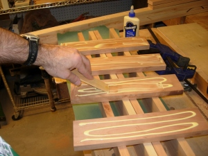 "Glueing the 13"" pieces to the ends"