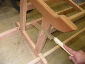 Cutting off the excess tenons and dowels
