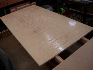 Coating the plywood with glue
