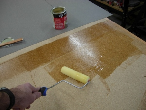 Applying the adhesive with a roller