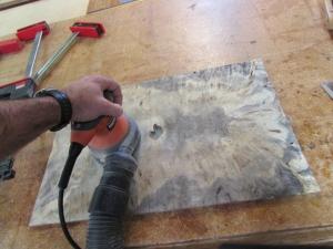 Sanding down the veneer