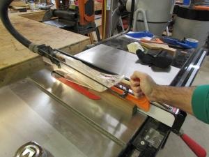 Cutting a strip of walnut