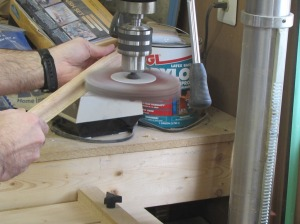 Using a mop sanding wheel
