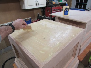 Covering the base tops with glue