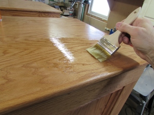 Brushing a third coat on the tops