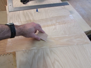Apply a thin layer of wood glue to each surface