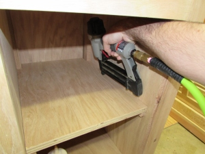 Glueing and nailing the shelf