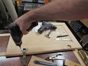 Attaching the hinges to the door panel