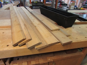 Scrap cedar siding and a window box